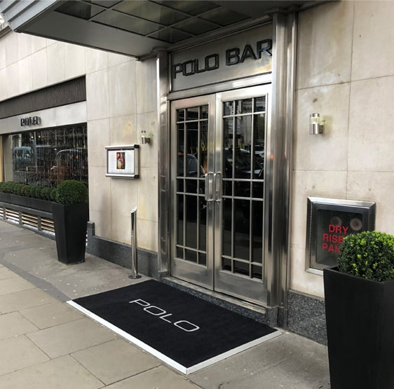 Mat Rental vs Mat Ownership Blog Image - London Bar with Fitted Entrance Mats